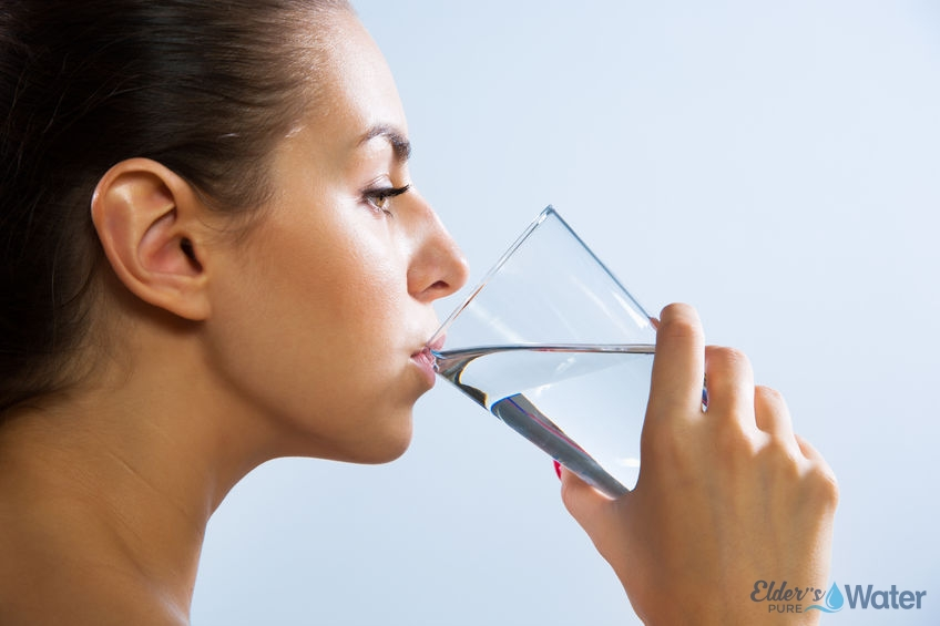 Woman drinks glass of water