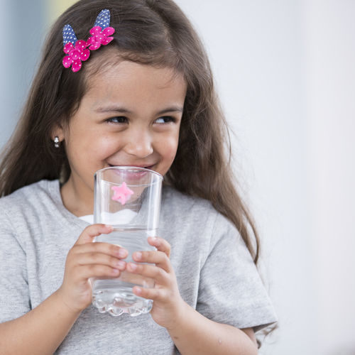 Girl Enjoys Water After Drinking Water Treatment